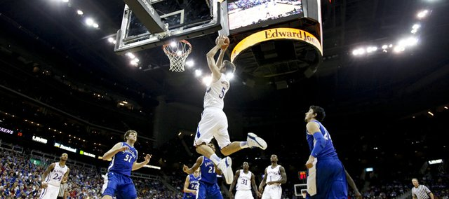Kansas center Jeff Withey soars in for an alley-oop dunk against Saint Louis in the first half of the championship game of the CBE Classic, Tuesday, Nov. 20, 2012 at the Sprint Center in Kansas City, Missouri.