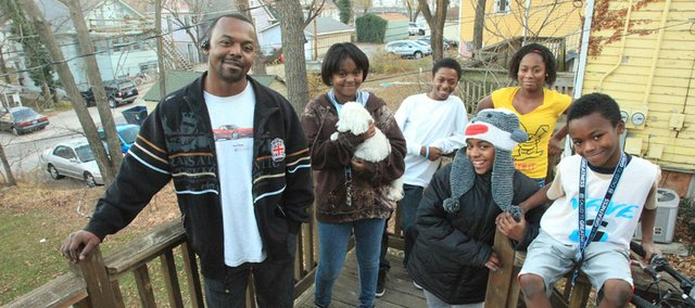 Isiah Linnear, 41, and his children, from left, Lezley, 14, Isiah, 15, Kourtney, 17, Britney, 11, and Joshua, 9, now have a place to call home, with the help of the Lawrence Family Promise program, a local organization that works with local churches and volunteers to help homeless families secure permanent housing.