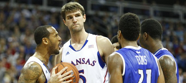 Kansas guard Travis Releford celebrates a bucket by center Jeff Withey and a foul by Saint Loui