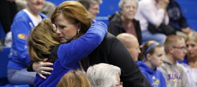 Kansas head coach Bonnie Henrickson gets a hug from Jefferson County resident Whitney Van Dyke, following the Jayhawks' 76-59 win over Alabama A&M, which was Henrickson's 300th career win, Friday, Nov. 23, 2012 at Allen Fieldhouse.