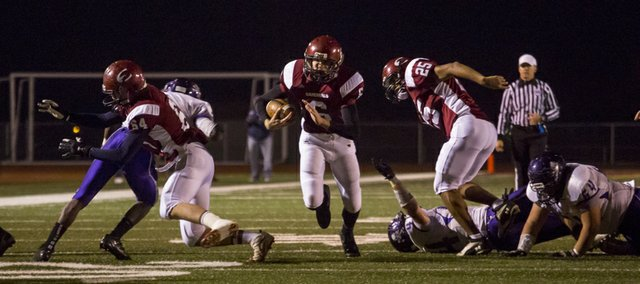 Eudora's Andrew Ballock (6) sprints through an opening in the Piper defense during Eudora's game against Piper in the Kansas Class 4A Sub-state championship, Friday, Nov. 16, 2012 in Eudora.