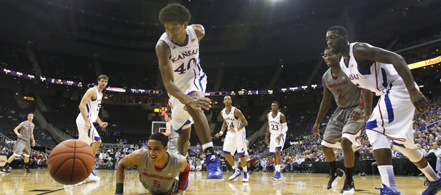 Kansas forward Kevin Young and Washington State guard Will DiIorio chase down a loose ball during the second half of the CBE Classic, Monday, Nov. 19, 2012 at the Sprint Center in Kansas City, Missouri.