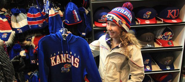 Grace Whitman, 11, of Woodbury, Minn., shops for Jayhawk merchandise on Black Friday at Jock's Nitch, 837 Massachusetts St. Downtown store owners are hoping residents will participate in Small Business Saturday today and make an effort to buy from local shops.