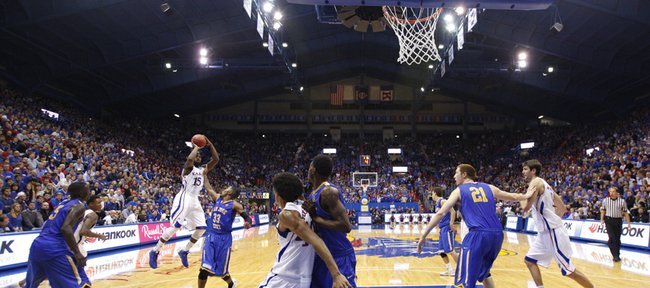 Kansas guard Elijah Johnson pulls up for a bucket over San Jose State guard James Kinney to end the Jayhawks' field goal drought during the second half on Monday, Nov. 26, 2012 at Allen Fieldhouse.