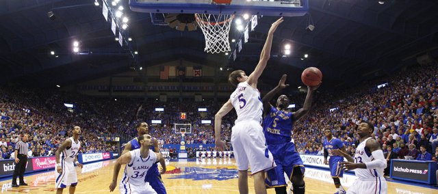 Kansas center Jeff Withey gets a long arm over a shot by San Jose State guard Xavier Jones during the first half on Monday, Nov. 26, 2012 at Allen Fieldhouse.