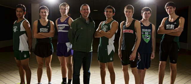 The Journal-World All-Area boys cross country team, from left: Luis Murillo, De Soto; Trail Spears, Free State; Ethan Hartzell, Baldwin; coach of the year Chris McAfee, De Soto; runner of the year Angel Vasquez, De Soto; Gavin Fischer, Lawrence; Brandon McCaffrey, Bishop Seabury; and Ryan Liston, Free State.