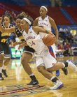 Kansas' CeCe Harper (24) drives past Cierra Ceazer during Kansas' game against Grambling State Wednesday, Nov. 28, 2012 in Allen Fieldhouse.