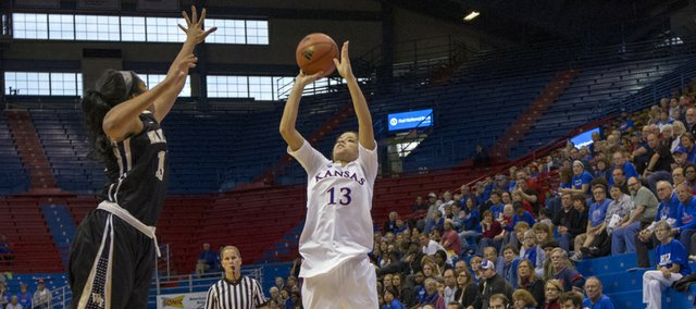 Kansas guard Monica Engelman (13) fires a shot over the outstretched hand of Mykala Walker during Kansas' game against Wake Forest, Sunday, Nov. 18. 2012 at Allen Fieldhouse. Kansas held off Wake Forest 64-58 and improved its record to 3-0 on the season.