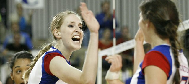 Kansas University's Caroline Jarmoc, left, celebrates a kill with Erin McNorton during the Jayhawks' volleyball match against No. 19 Iowa State on Wednesday, Sept. 26, 2012 at Horejsi Center.