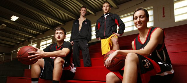 Lawrence High seniors, from left, Jake Mosiman, basketball; Adam Edmonds, swimming; Hunter Haralson, wrestling; and Emma Kelly, basketball, hope to lead the Lions to successful winter sports seasons.