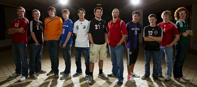 The Journal-World All-Area Boys Soccer team, from left: Matt Saathoff, Tonganoxie; Connor Henrichs, Lawrence; Mason Bandre, Baldwin; Keaton Truesdell, Tonganoxie; Taylor Phongsavath, De Soto; player of the year Justin Riley, Lawrence; coach of the year Brian Kroll, Tonganoxie; Nicholas Joslyn, Baldwin; Johannes Reiber, Lawrence; Asher Huseman, Tonganoxie; and Alex Trent, Free State.
