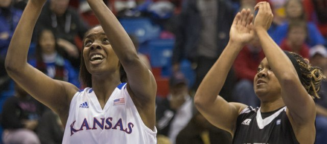 Kansas' Chelsea Gardner (15) moves past Cierra Ceazer (4) makes a move past Victoya Ricks (00) during Kansas' game against Grambling State Wednesday, Nov. 28, 2012 in Allen Fieldhouse.