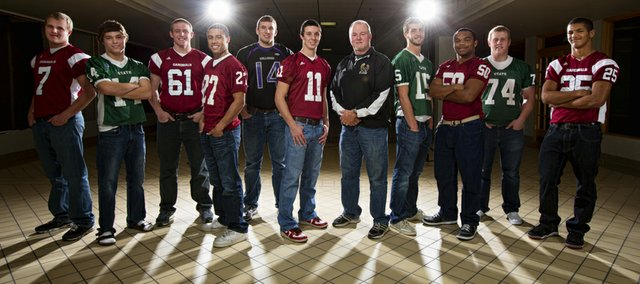 The Journal-World All-Area football team, from left: Gabe Cleveland, Eudora; Tye Hughes, Free State; Nick Becker, Eudora; Erick Mayo, Lawrence; Dayton Valentine, Baldwin; player of the year Brad Strauss, Lawrence; coach of the year Bob Lisher, Free State; Kyle McFarland, Free State; Kharon Brown, Lawrence; Cody Stanclift, Free State; and Markis Hill, Eudora.