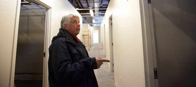 Loring Henderson, director of the Lawrence Community Shelter, provides a tour Thursday of the new homeless shelter facility, which is located at 3701 Franklin Park Circle. The shelter, which is still undergoing some finishing construction touches and will not be move-in ready until the end of the year, will be open to the public during an open house from noon to 4 p.m. on Sunday.