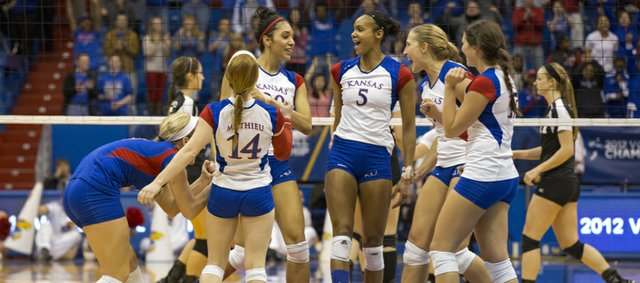 Kansas players celebrate their opening round NCAA tournament volleyball match victory over Cleveland State Friday, Nov. 30, 2012 at Allen Fieldhouse. With the win the Jayhawks advance to face Wichita State tomorrow at 6:30 p.m.