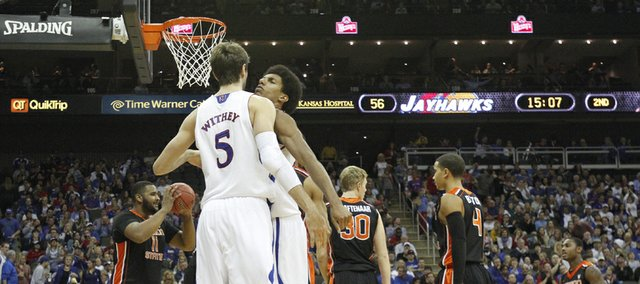 Kansas forward Kevin Young chest bumps center Jeff Withey after converted a bucket while being fouled by Oregon State during the second half on Friday, Nov. 30, 2012 at the Sprint Center in Kansas City, Missouri. At left is OSU center Joe Burton, who played in high school against Withey.