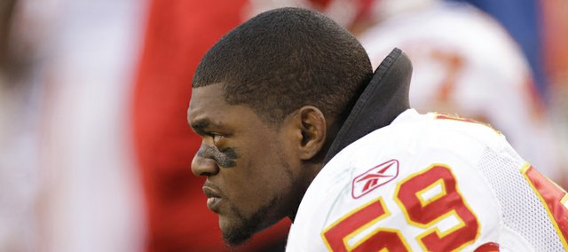 In this Dec. 11, 2011, file photo, Kansas City Chiefs' Jovan Belcher sits on the sidelines during the third quarter of a game against the New York Jets in East Rutherford, N.J. Police say Belcher fatally shot his girlfriend early Saturday, Dec. 1, 2012, in Kansas City, Mo., then drove to Arrowhead Stadium and committed suicide in front of his coach and general manager.
