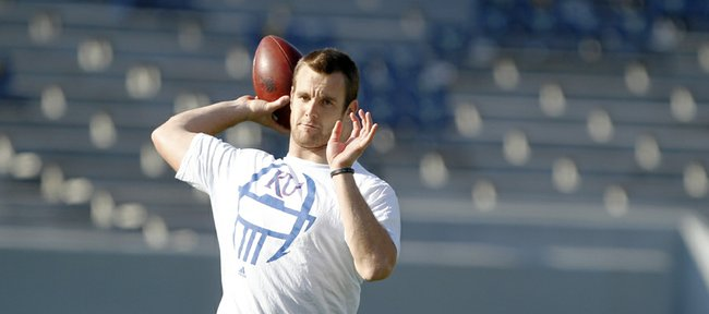 Kansas quarterback Dayne Crist throws the ball during pre
