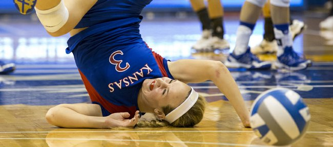 Kansas' Brianne Riley gets turned upside down as she is unable to make a dig during Kansas' second round NCAA tournament game against Wichita State, Saturday, Dec. 1, 2012 in Allen Fieldhouse. The Jayhawks fell, 3-1, and with the loss their season ended.