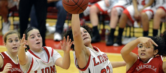 Anna Wright (24) and Kionna Coleman (33) reach for the rebound as Lawrence High's girls basketball played Emporia during the season opener Friday, Nov. 30, 2012, at LHS.