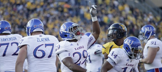 Kansas running back James Sims (29) celebrates a touchdown in KU's last football game Saturday against West Virginia University in Morgantown, W.Va.