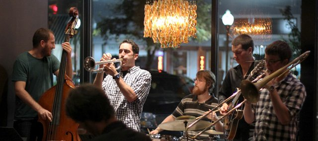 Trumpeter Tommy Johnson Jr. performs with his band Blueprint recently at Five Bar and Tables, 947 Massachusetts St., Other members of the band are Brian Scarborough (trombone), Lucas Parker (guitar), Dave Wasecha (bass) and Max Allsbrooks (drums).