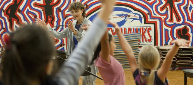 Music teacher Lois Orth-Lopes leads students at Cordley School in a program rehearsal Thursday. Orth-Lopes is part of a team that's developing a new teacher evaluation system for the Lawrence district.