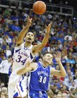 Kansas forward Perry Ellis grabs a loose ball over Saint Louis forward Jake Barnett in the second half of the championship game of the CBE Classic, Tuesday, Nov. 20, 2012 at the Sprint Center in Kansas City, Missouri.