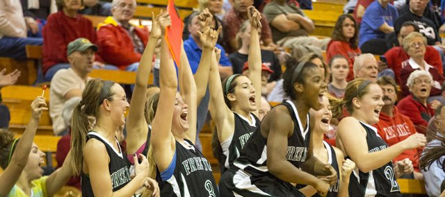 Free State's bench reacts to a point scored late in the game during Free State's match up against Lansing, Saturday, Dec. 8, 2012 in Lansing.c
