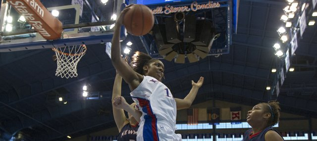 Kansas' Chelsea Gardner saves the ball from going out of bounds in front of Anna Sonka (3) and Naomi Rosales (31) during Kansas' game against Newman, Sunday, Dec. 9, 2012 in Allen Fieldhouse. Kansas won 97-64.