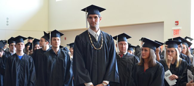 Kansas University center Jeff Withey, center, stands among the D