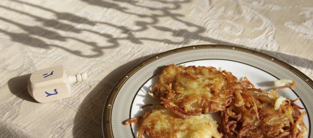 In addition to lighting the menorah and playing the dreidl, It's a Jewish tradition to prepare and eat traditional potato latkes — fried in oil — during Hanukkah. These were made by Nechama Tiechtel at Lawrence's Chabad Jewish Center.