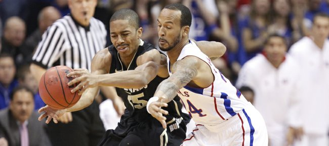 Kansas guard Travis Releford knocks the ball away from Colorado guard Spencer Dinwiddie during the first half on Saturday, Dec. 8, 2012 at Allen Fieldhouse.