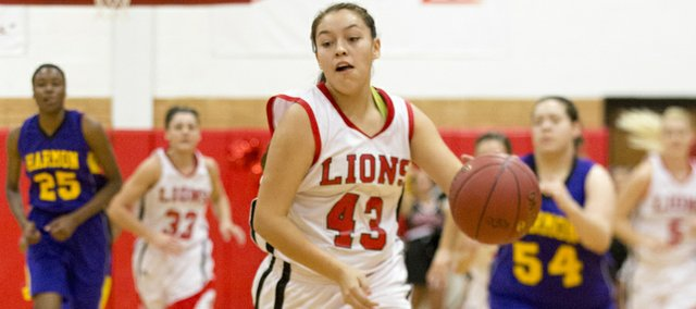 Lawrence High's Jolona Shield (43) beats the defense down the court on a fast break during Lawrence High's game against Harmon, Monday, Dec. 10, 2012 at LHS.