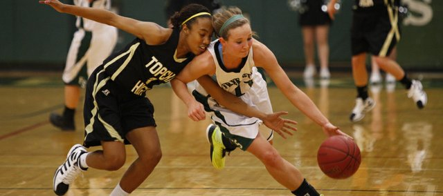 Free State senior Kennedy Kirkpatrick gets a steal from Topeka High junior Jailyn Lee during the first half on Tuesday, Dec. 11, 2012 at Free State High School.