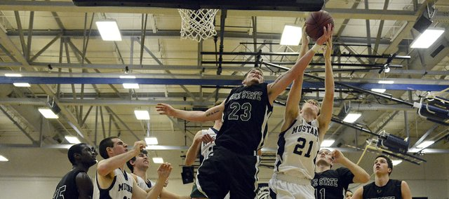 Free State's Cody Scott (23) fights for a rebound late in the second half during the Firebirds' game against Blue Valley North on Tuesday in Overland Park.