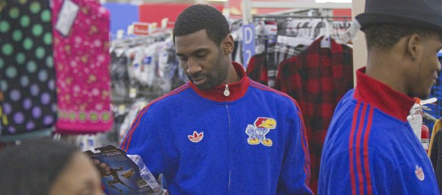 KU junior Justin Wesley sports a broken finger as he looks for gifts on Thursday, Dec. 13, 2012, during the Jayhawks&#39; holiday shopping excursion to Wal-Mart.