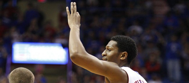 "Kansas guard Andrew White signals ""three"" as he heads back on defense against Belmont during the second half on Saturday, Dec. 15, 2012 at Allen Fieldhouse."