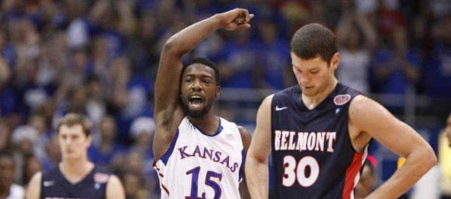Kansas guard Elijah Johnson raises up the fieldhouse after an alley-oop dunk from center Jeff Withey against Belmont during the first half on Saturday, Dec. 15, 2012 at Allen Fieldhouse. In front is Belmont forward Trevor Noack.