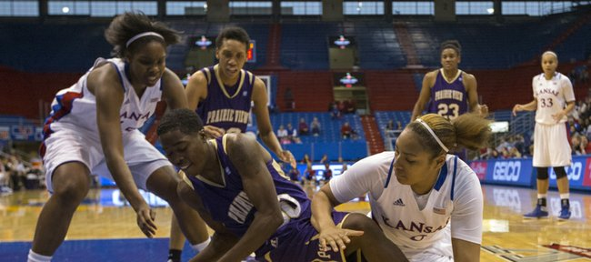 Kansas' Chelsea Gardner, left, and Asia Boyd, right, scramble to try to get the ball away from Jaquandria Williams during Kansas' game against Prairie View A&M, Sunday, Dec. 16, 2012 at Allen Fieldhouse.