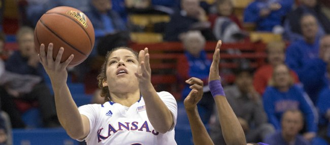 Kansas&#39; Monica Engelman (13) floats past Kiara Etienne on her way to the basket during Kansas&#39; game against Prairie View A&amp;M, Sunday, Dec. 16, 2012 at Allen Fieldhouse.
