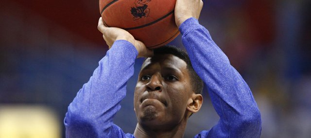 Kansas guard Andrew White puts up a shot prior to tipoff against Richmond on Tuesday, Dec. 18, 2012 at Allen Fieldhouse.