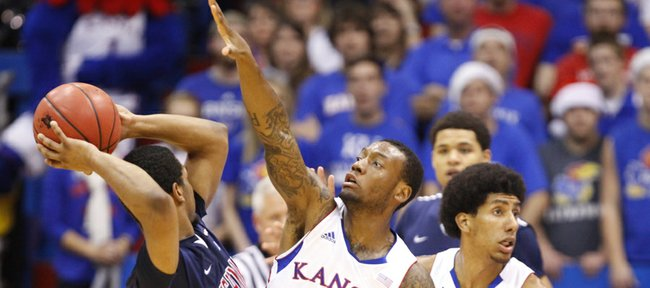 Kansas guard Naadir Tharpe defends against a pass from Richmond guard Cedrick Lindsay during the second half on Tuesday, Dec. 18, 2012 at Allen Fieldhouse.