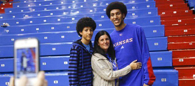 Kansas University forward Kevin Young, right, poses for a family portrait with younger brother Donovan Young and mother Alicia Morales after Tuesday's game against Richmond at Allen Fieldhouse.