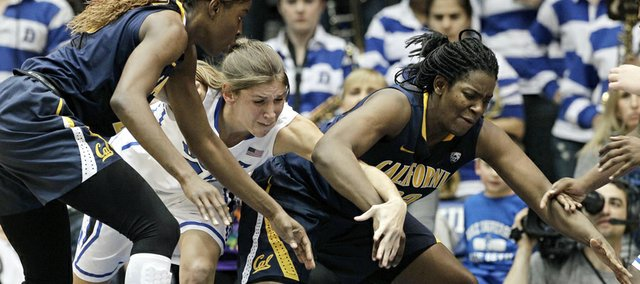 Duke's Allison Vernerey, center, reaches for the loose ball against California's Gennifer Brandon, left, and Talia Caldwell during the second half of an NCAA women's college basketball game in Durham, N.C., Sunday, Dec. 2, 2012. Duke won 77-63.