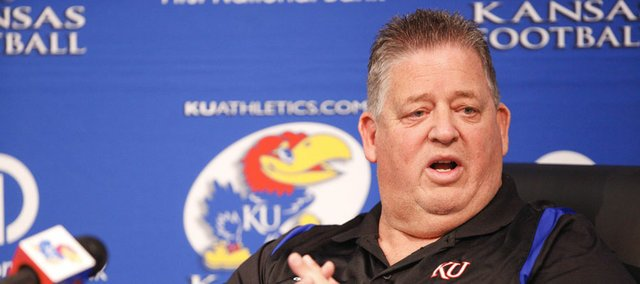 Kansas University football coach Charlie Weis discusses KU's recently signed junior-college transfers at a news conference on Thursday, Dec. 20, 2012, at KU.