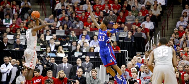 Kansas guard Ben McLemore swoops in to defend against a shot from Ohio State forward Sam Thompson during the second half on Saturday, Dec. 22, 2012 at Schottenstein Center in Columbus, Ohio.