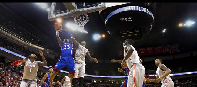 Kansas guard Ben McLemore soars in for a bucket and a foul from Ohio State guard Shannon Scott during the second half on Saturday, Dec. 22, 2012 at Schottenstein Center in Columbus, Ohio.