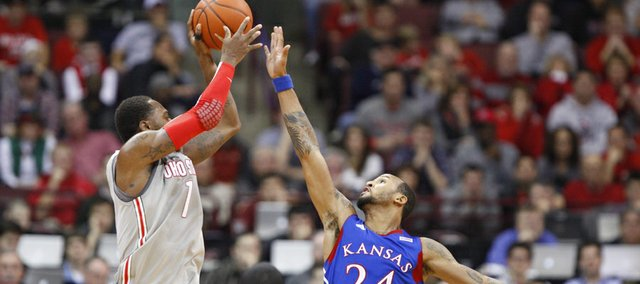 Kansas guard Travis Releford extends to defend against a shot by Ohio State forward Deshaun Thomas during the second half on Saturday, Dec. 22, 2012 at Schottenstein Center in Columbus, Ohio.