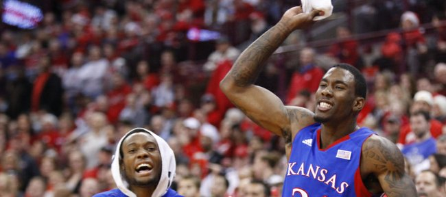 Kansas forward Jamari Traylor (31) and Naadir Tharpe celebrate a bucket against Ohio State late in the second half on Saturday, Dec. 22, 2012 at Schottenstein Center in Columbus, Ohio.